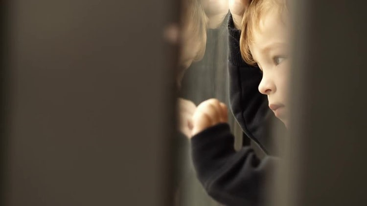 Boy Looking Through The Window : Stock Video