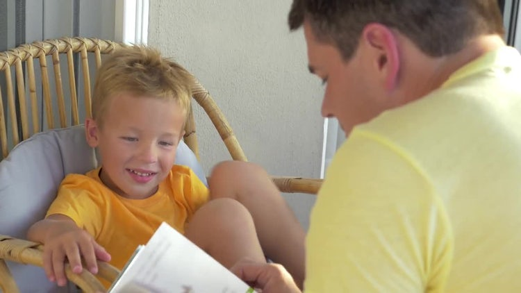 Boy Listening To Father Reading: Stock Video