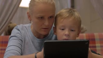 Mother And Son Using Tablet : Stock Video