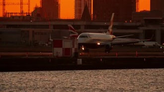 Large Airliner Landing During Sunset: Stock Video