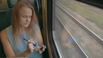 Woman Applying Makeup On Train: Stock Video