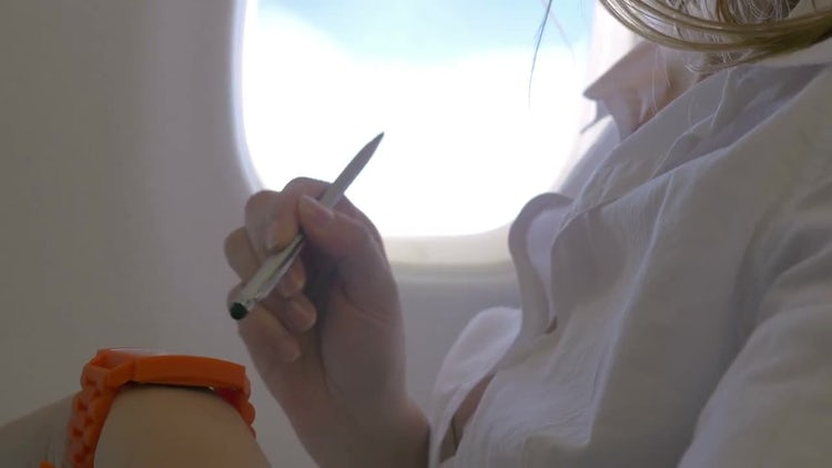 Using Smart Watch In Plane: Stock Video