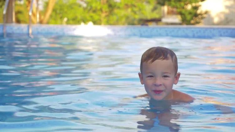 A Cute Little Boy Swimming : Stock Video