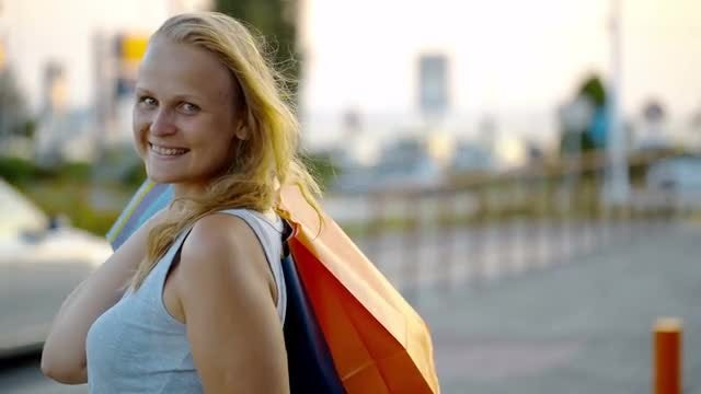 Smiling Woman With Shopping Bags: Stock Video