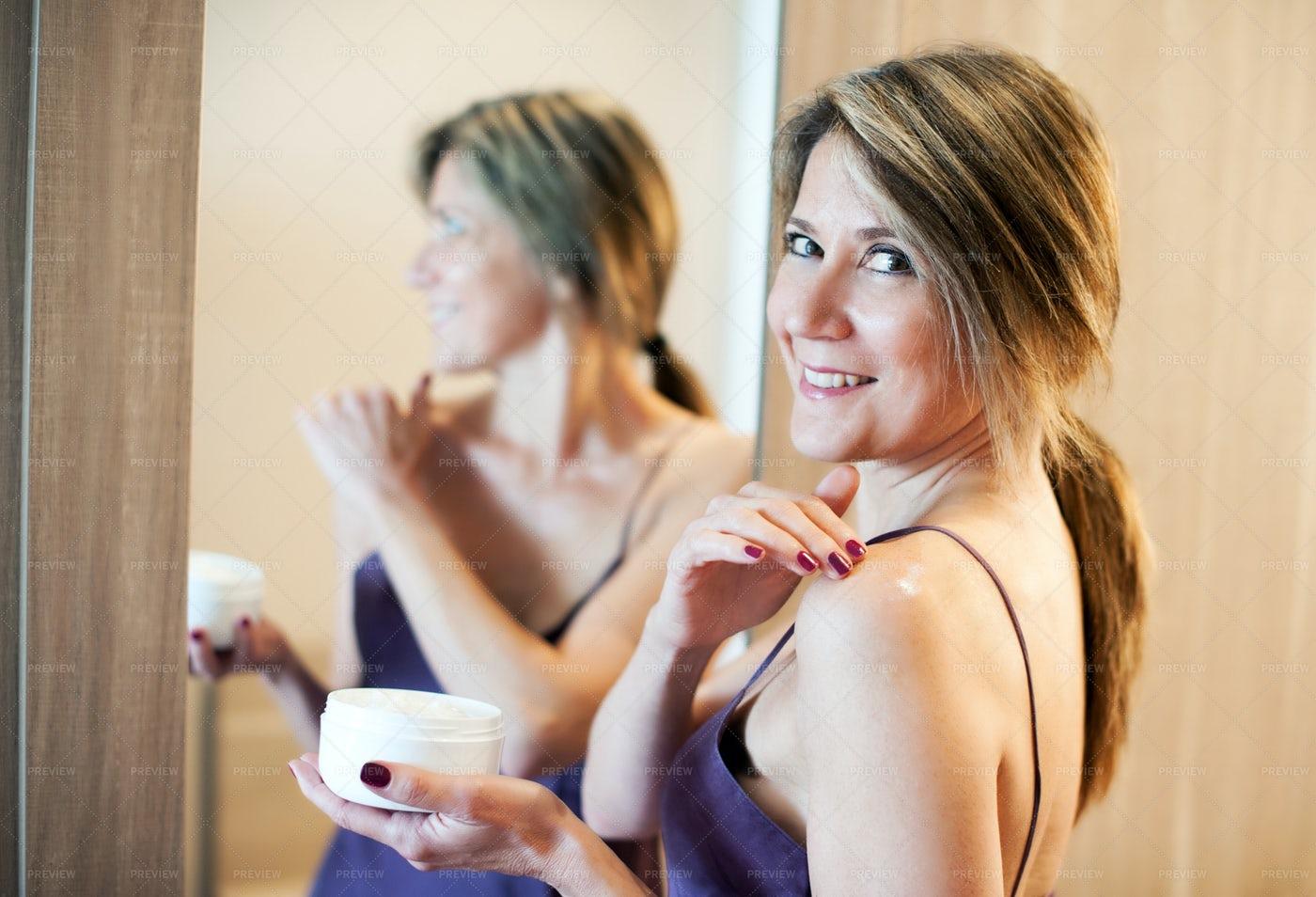Woman Applying Cream: Stock Photos