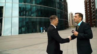 Two Businessman Shaking Hands: Stock Video