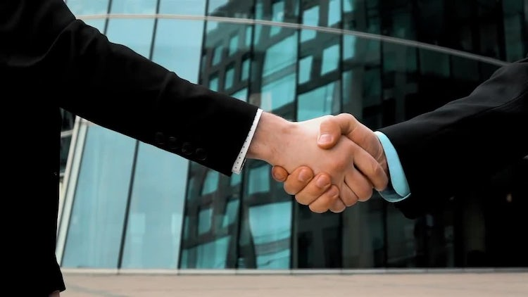 Two Businessmen Shaking Hands: Stock Video