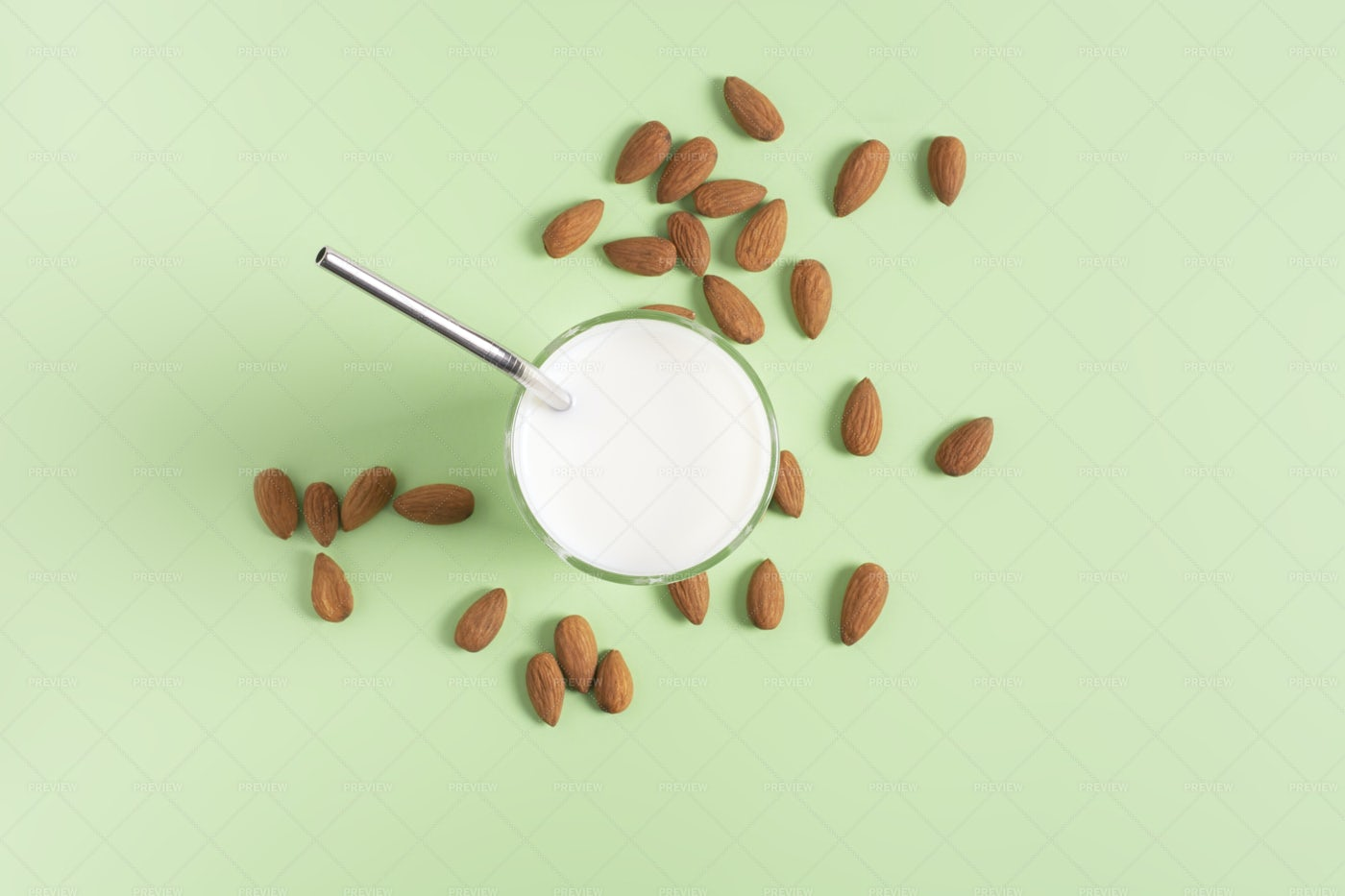 Almond Milk With A Straw: Stock Photos