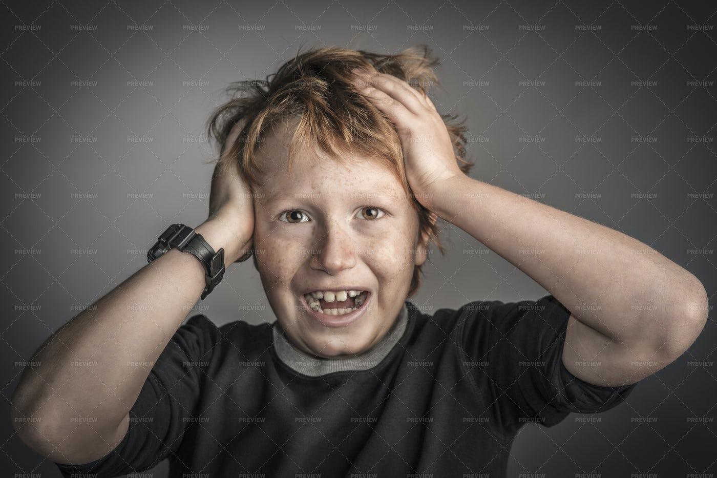 Boy Holds His Head: Stock Photos