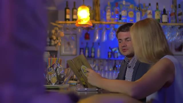 Young Couple Discussing A Menu: Stock Video