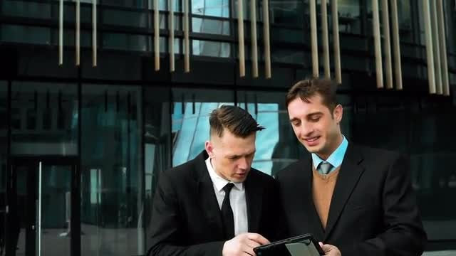 Young Businessmen Discussing Business Outdoors: Stock Video
