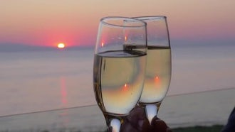 Clinking Champagne Glasses Against Sunset: Stock Video