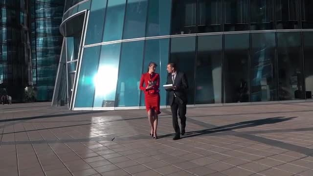 Colleagues Walking In Slow Motion: Stock Video