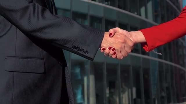 Man And Woman Shake Hands: Stock Video