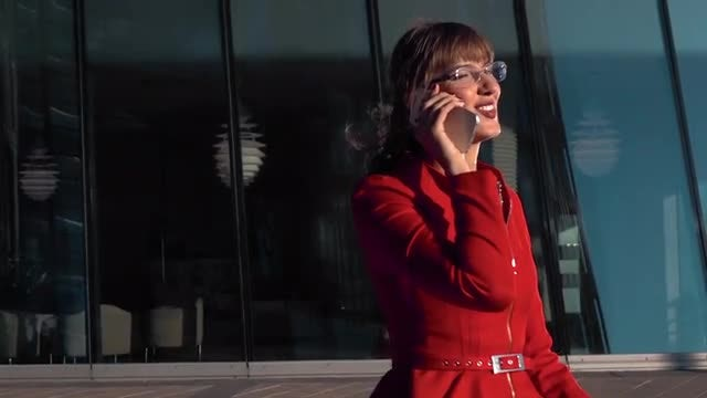 Businesswoman Talking On The Phone: Stock Video