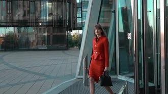 Woman Walks Along Business Center: Stock Video