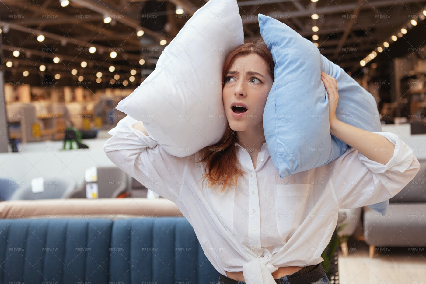 Covering Ears With Pillows: Stock Photos