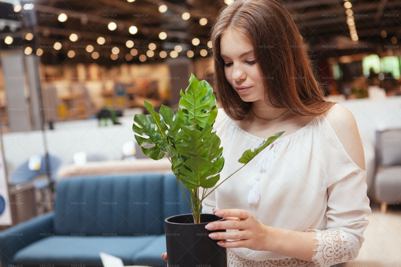 Woman Buying Potted Plant: Stock Photos
