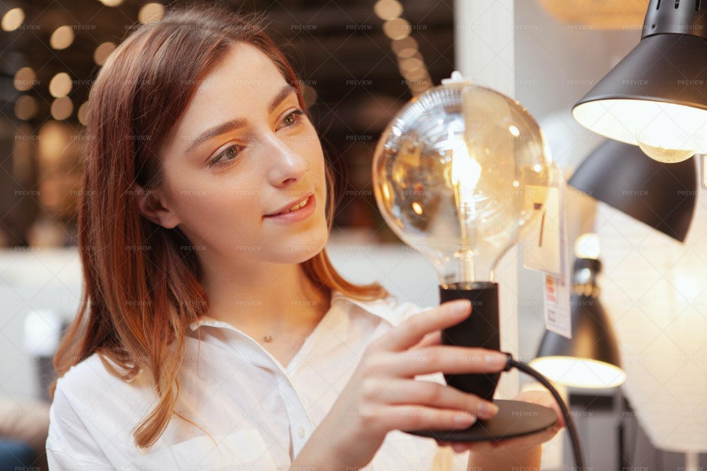 Woman Holding Lightbulb: Stock Photos