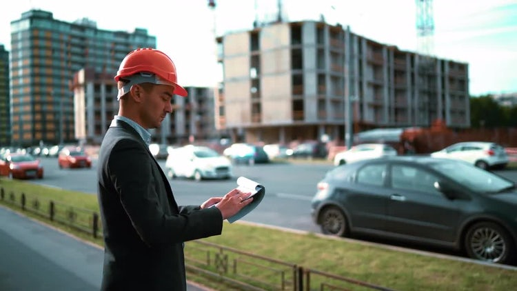 Male Architect Inspecting Construction Site: Stock Video
