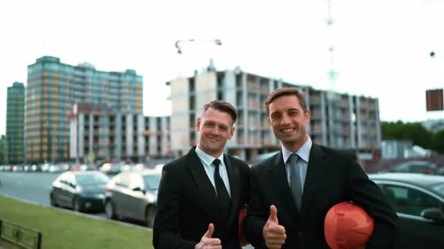 Two Architects Gives Thumb Up: Stock Video