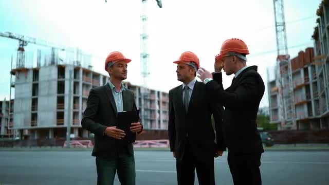 Engineer Giving Clients Hard Hats: Stock Video