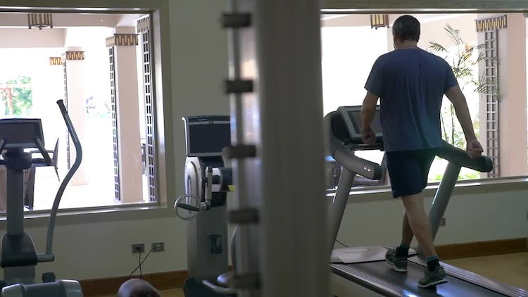 Man Walking On A Treadmill: Stock Video