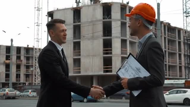 Customer And Architect Shake Hands: Stock Video