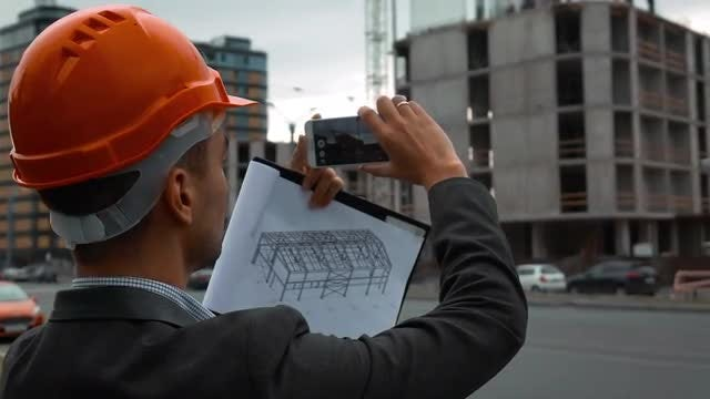 Engineer Takes Photos Of Construction : Stock Video