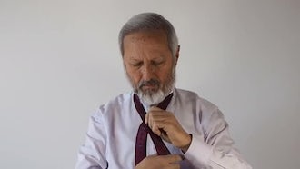 Old Man Tying A Tie: Stock Video