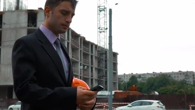 Young Construction Engineer Answering Call: Stock Video