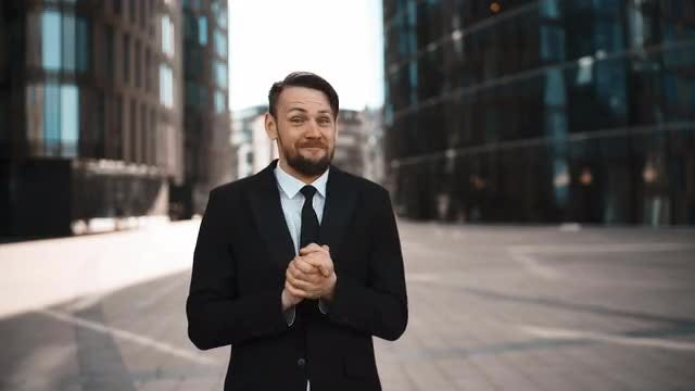 Excited Businessman On The Street: Stock Video