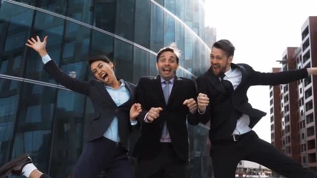 Businesspeople Celebrate Winning Victory: Stock Video