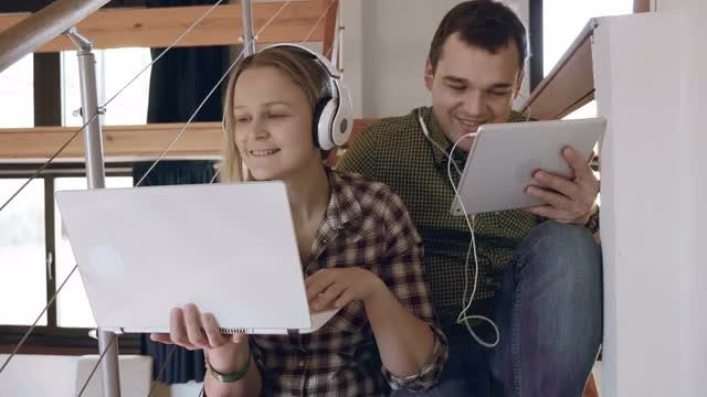 Enjoying Music On Gadgets: Stock Video