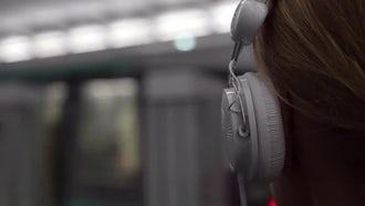 Girl Listening To Music In Metro: Stock Video