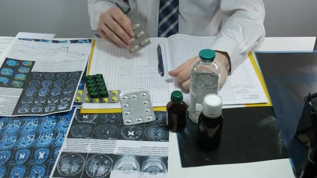 Male Doctor Prescribing Medicine: Stock Video