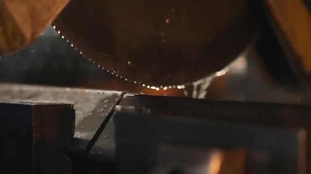 Factory Worker Sawing Steel : Stock Video
