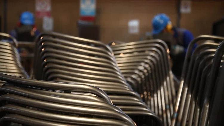Factory Workers Wielding Steel Pipes: Stock Video