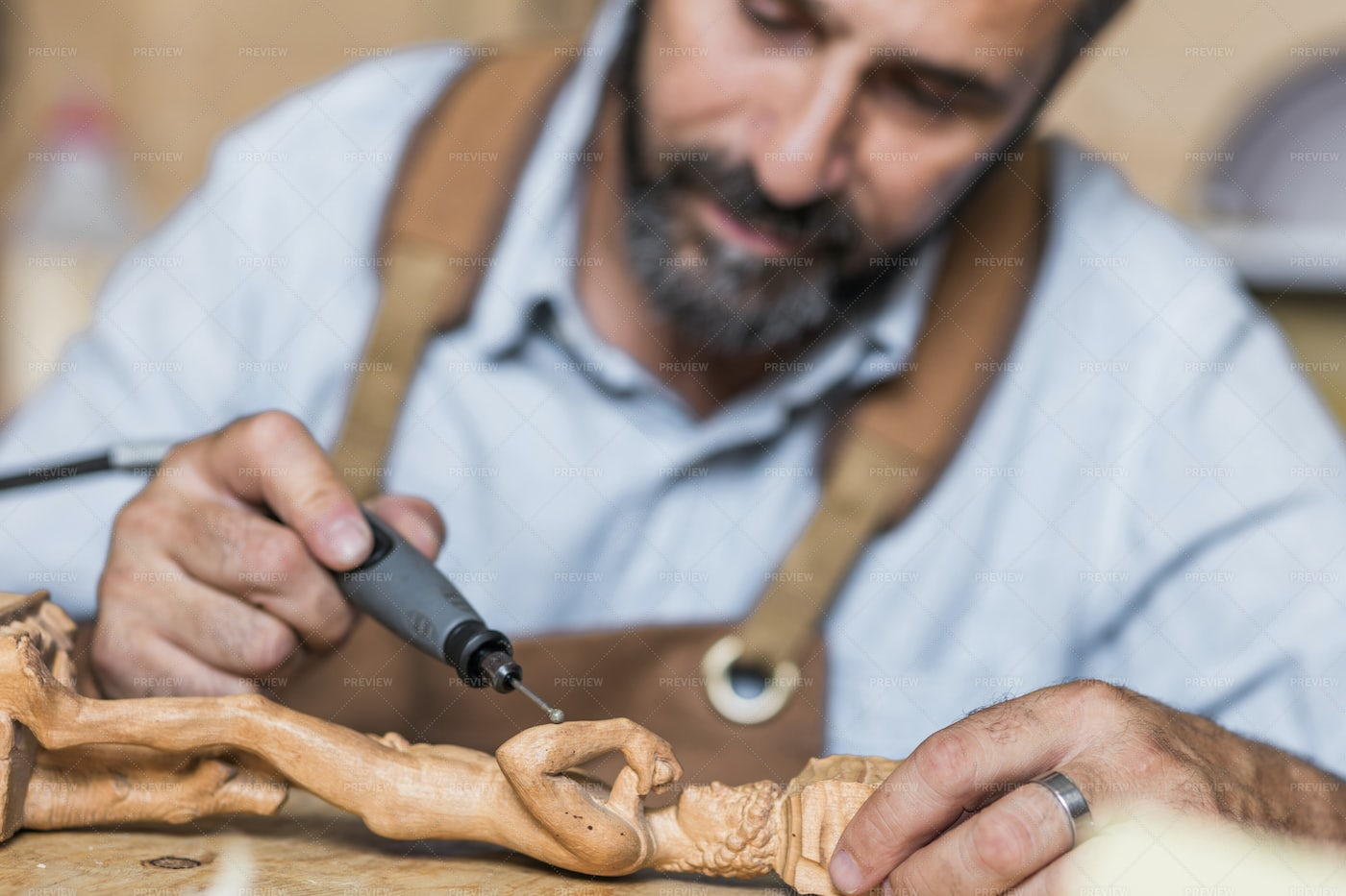 Sculptor Working With Drill: Stock Photos