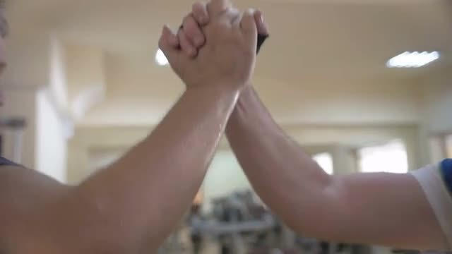 Firm Handshake In A Gym: Stock Video