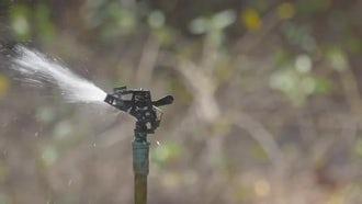 Water Sprinkler In Slow Motion: Stock Video