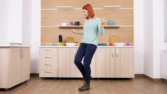Beautiful Lady Dancing In Kitchen: Stock Video