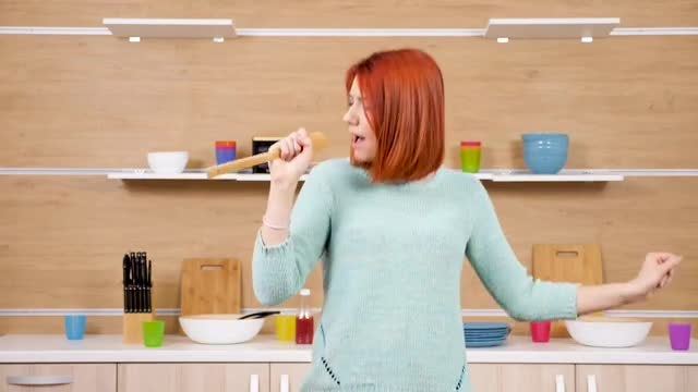 Woman Singing In The Kitchen: Stock Video