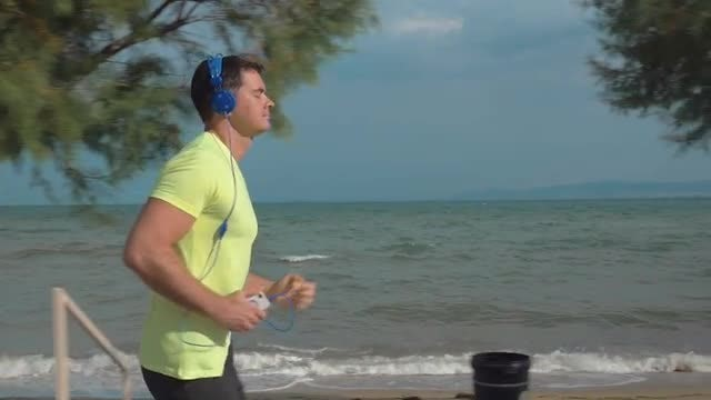 Jogging By The Seaside: Stock Video