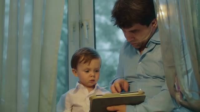 Father-Son Use Tablet Computer: Stock Video