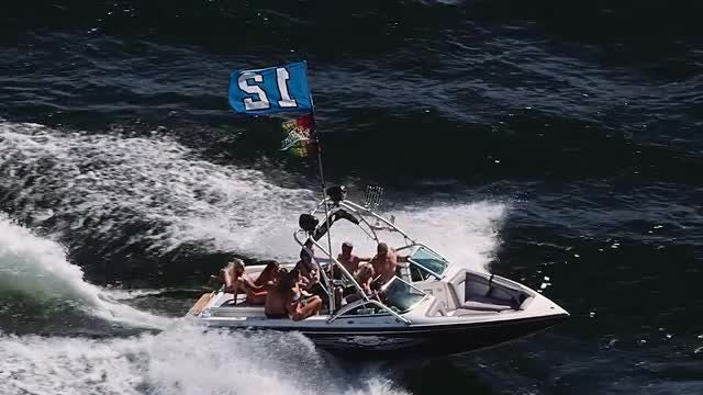 Football Fans Sailing On Power Boat : Stock Video