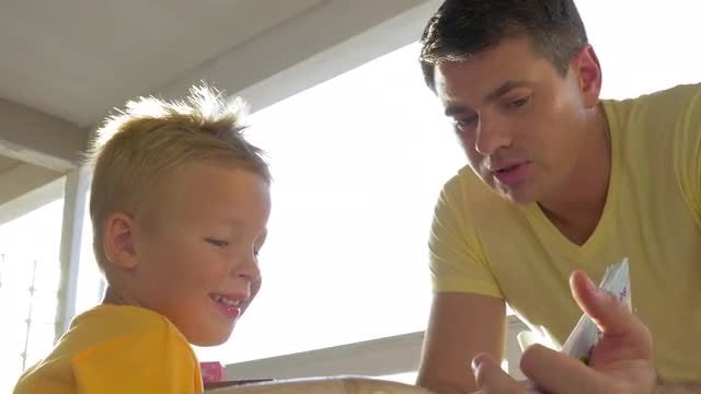 Father Teaching His Young Son: Stock Video