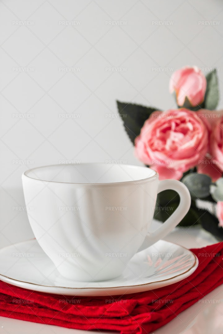 Cup And Flowers: Stock Photos