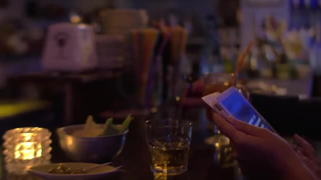 Using Tablet In A Bar : Stock Video