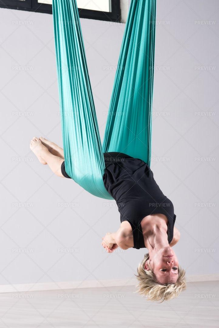 Aerial Yoga Arm Stretches: Stock Photos